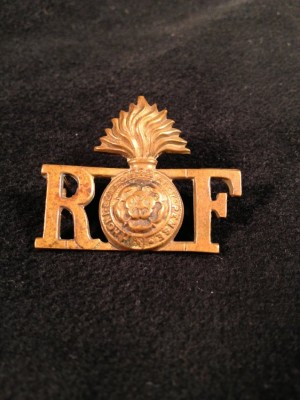 "This cap pin, belonging to Simon Soibel, still bears the initials RF, even though the Royal Fusiliers units, the 39th and 40th battalions, were already referred to as the ""Jewish Legion."" 1992.154.057"