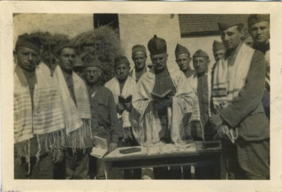 These include an image of a rabbi and troops at a Passover seder in Paris in 1918, 1993.173.1.15