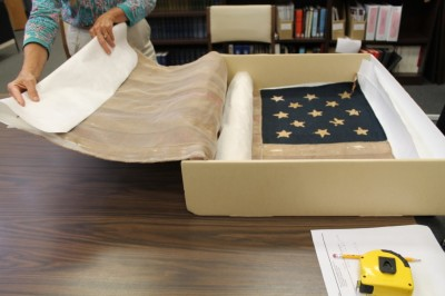 Packing the flag safely away again, ready for more conservation work.