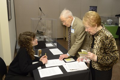 Researcher Alicia Puglionesi collects stories from attendees.