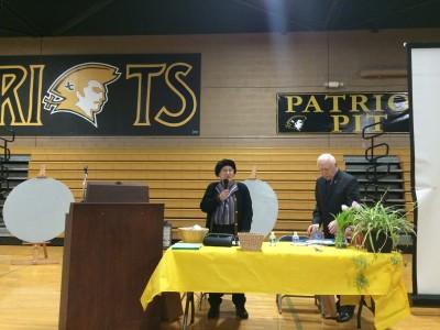Esther Kaidonow speaking.