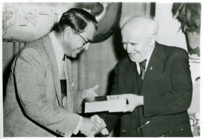 reenstein receiving a book from Prime Minister, David Ben Gurion, 1949. JMM 1971.20.192