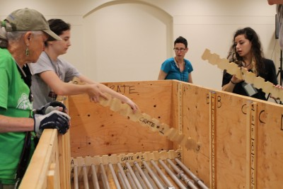 The poles were also placed in the wooden crates tactically so that when it would be ready to set up in Texas, the poles that would be going on the floor (the foundation) would be the first to come out of the box. That way, the exhibit can literally be built from the bottom-up.