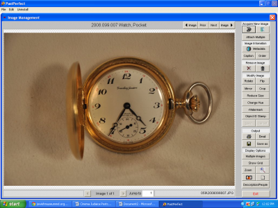 A gold colored pocket watch featuring military time from Greenburg Jeweler.