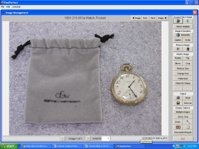 A pocket watch given to Reuben Kramer for his Bar Mitzvah by his parents in 1922, kept in a velvet jewelers bag which came with it.