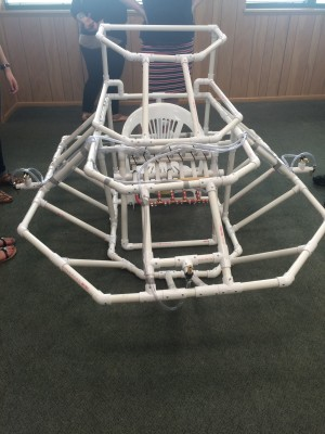 This is a project that was completed at a STEM summer camp for blind high school students. Students worked together to solve a problem—in this case, an asteroid plummeting toward Earth—and built this solution, some sort of spacecraft.