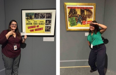Collections Intern Kaleigh Ratliff, and Education and Programming Intern Falicia Eddy encourage visitors to vote for, and take pictures by their favorite poster.