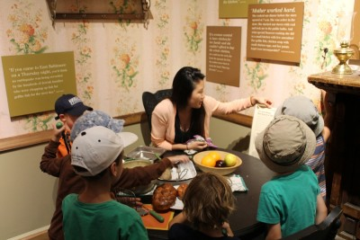"""I've never been one to simply observe, so here I am """"making"""" a traditional Sabbath dinner with some of the kids while reading them the newspaper."""
