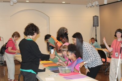 Museum staff assist BELL campers during art activity.