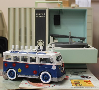 Pictured is a blue and white metal menorah shaped like a VW bus.