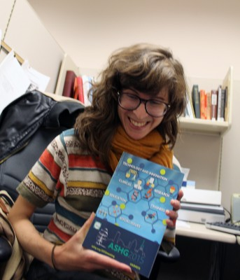 Alicia poses with the conference catalog.