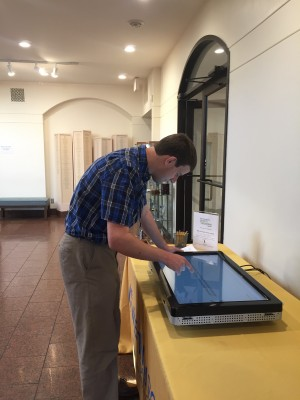 Visitor Services Coordinator, Graham Humphrey, tests the new computer activity.