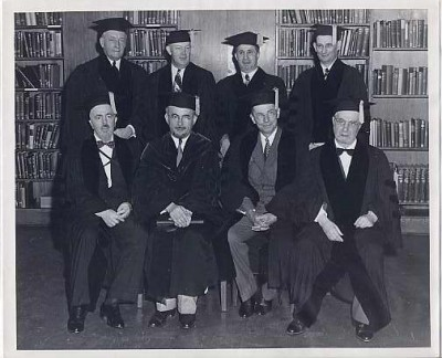 Dr. Joseph Schwartz, back right, and other men in academic regalia, n.d.