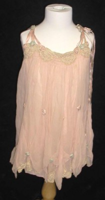 Flower girl dress, donated by Bernice Weinstein. JMM 2003.63.1