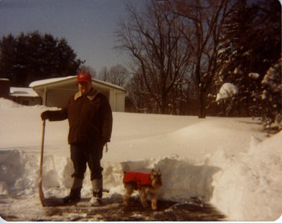 2009.014.005 – John Marsiglia with his dog, Mickey in Pikesville, 1992/1993 – Of course, not everything about the snow is fun but I'm sure the work goes much quicker when you have a pet by your side.