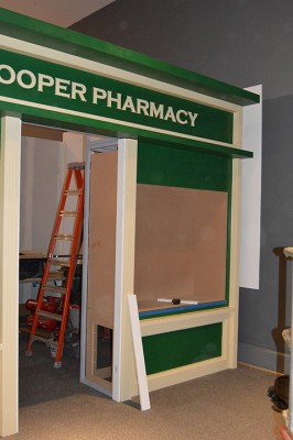 Not all the walls are purely functional; here's the pharmacy window, almost finished (with the movie screen from Paul Simon: Words and Music behind it, waiting to be painted).