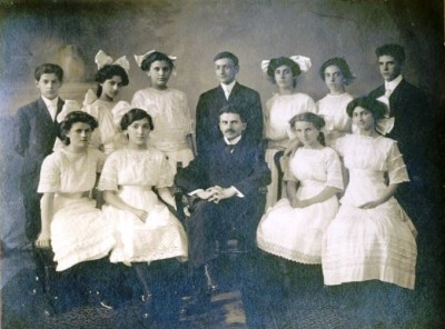 The Har Sinai confirmation class of 1911. (The book's protagonist is glad to learn that the Rosenbach family's laundry is sent out, so she won't have to do more than iron; take a look at these nice white dresses and you'll understand her relief!) Donated by Audrey Fox. JMM 1994.189.1