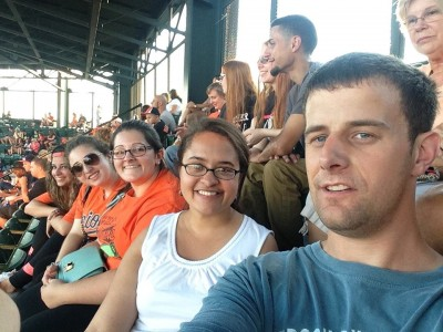 Enjoying baseball with the interns