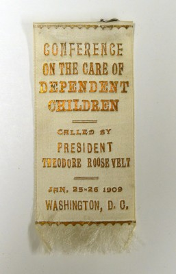 "Satin ribbon with safety pin, made by G.N. Meyer Mfg., Washington, D.C. ""Conference on the Care of Dependent Children, Called by President Theodore Roosevelt, Jan. 25-26 1909, Washington, D.C.""  Gift of Judge Jacob M. Moses. JMM 1963.42.13c"