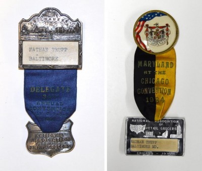 "Left: Satin ribbon with metal badges, including the skyline of Milwaukee. ""Nathan Trupp – Baltimore. Delegate 34th Annual Convention, July 6-7-8-9 1931. National Association of Retail Grocers."" Right: Satin ribbon with enamel and metal badges. ""Maryland at the Chicago Convention 1934. National Association of Retail Grocers. Nathan Trupp, Baltimore, Md."""