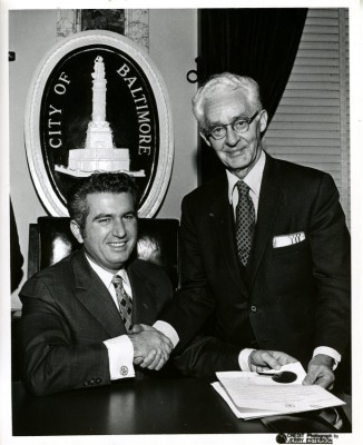 Here he shakes hands with Baltimore Mayor Tommy D'Alesandro.  Photo by Jerry Esterson, JMM 1996.026.273.
