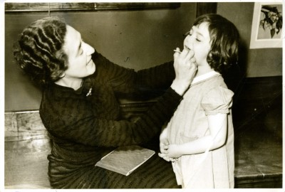 Dr. Lucille Liberles examines a young girl, JMM 1980.29.99b