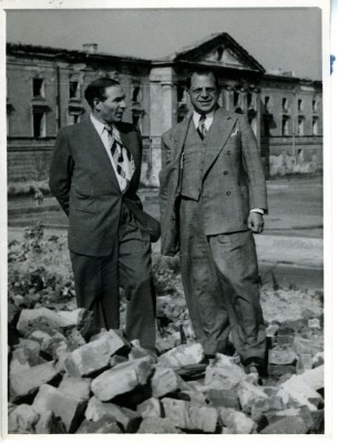 Harry Greenstein (right) and William Bein (left) JDC Director for Poland, standing on rubble of Warsaw Ghetto, Poland, 1949. JMM 1971.20.214