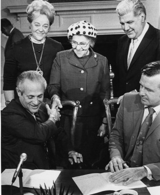 Abrams (standing, left) at the signing of a bill she co-sponsored, c. 1971. Governor Marvin Mandel is seated at left. JMM 1983.8.17.1