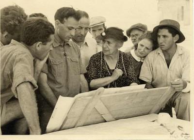 Henrietta Szold going over plans with madrichim at a kibbutz, c. 1938. JMM 1992.242.7.178