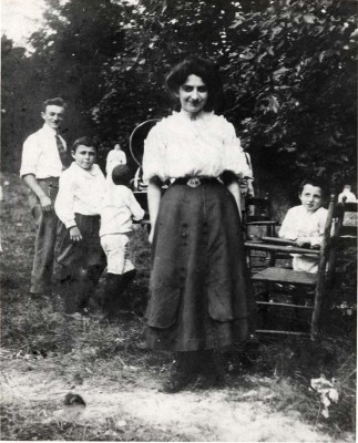 """Paradise Home"" in Catonsville. It was purchased by the Hebrew Benevolent Society to provide mothers and babies with country vacations. This was the earliest forerunner of Camp Woodlands, and later, New Camp Milldale. In the background is Dr. Harry Lindeu, medical student, who served as camp doctor. JMM 1995.98.30"