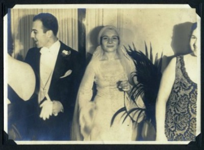 Florence smiles at the photographer while Howard greets a guest, 1932. Anonymous gift. JMM 1998.47.4.62