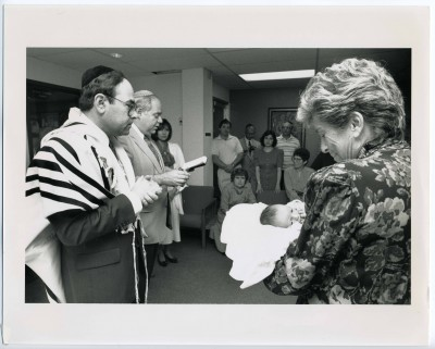 Rabbi Mark Loeb and Rabbi Michael Henesen conduct a B'rith at Baltimore Hebrew University, September 1990. JMM 2009.40.3895