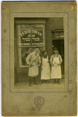 Brotman Meat Market and Poultry, 1119 E. Lombard Street, c. 1923. From left to right: unidentified, Sarah Schneiderman Brotman, and Hyman Brotman. Brotman Meat Market and Poultry was owned by Hyman, Isaac (Itzhak) and Milton Brotman. JMM 2011.47.1