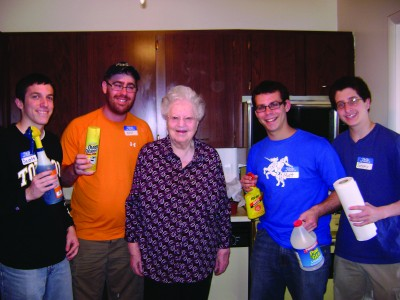 "Some ""Passover Partners"" help a neighborhood senior prepare her home for the Passover festival. Photo courtesy of the Associated: Jewish Community Federation of Baltimore."