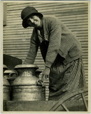 Unidentified woman posing with milk can, c.1924. JMM 1998.47.7.1