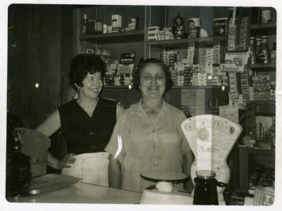 Faye Hershcovitz Zeller and friend behind the counter at Zeller's Meat Market and Deli. JMM 2006.4.103