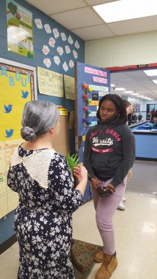 Natalie speaks with a student about her role as Henrietta