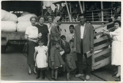 "Associated Jewish Charities mission to Israel, the note on the back is dated Nov. 4th, 1954 and reads: ""Darlings, This picture was taken in Haifa on Nov. 1st where we were fortunate enough to see a boat land with over 500 immigrants - mostly Morrocans and a few Egyptians. You can imagine the thrill as each one found his family and friends. Wish you could include this part of the world in your trip - it's really an eye opener and Bob dear, has real human interest. There are 63 different countries represented here, a real melting pot. Now on to the Neger. Best love, M."""