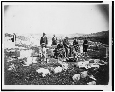 Group of tourists with indigenous people in cemetery outside walls of Jerusalem, c. 1860-1890. Courtesy of the Library of Congress.