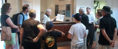 Volunteer Ernie begins a synagogue tour.