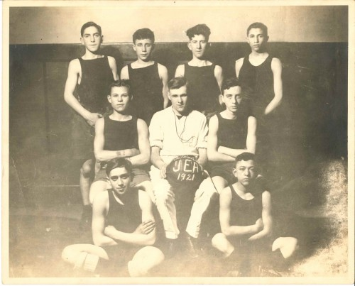 The JEA basketball team posed in the gymnasium, 1921. Jacob Kadish is in the top right. Gift of Shirley Kadish Davids, JMM 2017.1.1