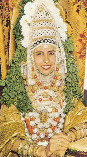 A bride in traditional Yemenite Jewish bridal vestment, in Israel 1958. Photo by Ba'Asor Le'Israel. Masada Publishing, Jerusalem, 1958. Via.