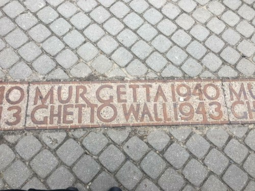 Placard of the Warsaw Ghetto. These stone inserts cover the extent of the wall and are all that remain to tell people where the Ghetto once stood.
