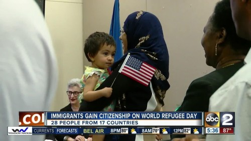 News coverage of the Jewish Museum's Naturalization Ceremony. Image from ABC2 News.