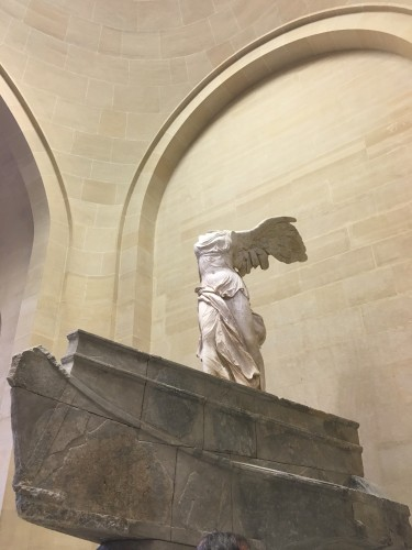 While at the Louvre, I was an experience-seeker who sought out famous art, such as the Nike of Samothrace.
