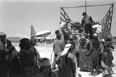 Immigrants from Iraq leaving Lod airport on their way to ma'abara, 1951. Via.