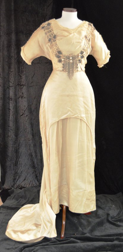 Wedding dress made of silk with beadwork on bodice and skirt, worn by Bessie Grossman when she married Louis Paymer, Jan. 3, 1911. Gift of Zelda Paymer Salkin and Lenore Paymer Snyder. JMM 1986.109.1