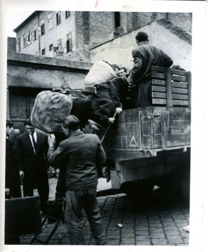 Rumanian refugees loading a truck with their belongings, leaving Budapest, Hungary. January 28, 1948 (JMM 1971.020.170)