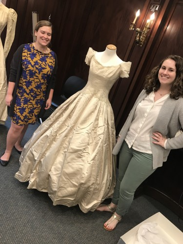 Interns Joelle and Amy posing with one of the many historic dresses they worked with this summer.