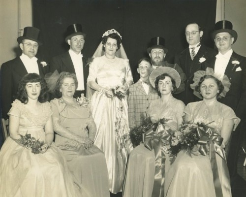 The bride and groom with their families and wedding party: the wedding of Rabbi Meyer Zywica and Frances Friedlander, June 11, 1950. Seated, left to right: Elaine Friedlander, Rebbitzen Rose Friedlander, Rebbitzen Esther Friedlander Rosenblatt, Hinda Feldman Esterson. Standing, left to right: Rabbi Yonah Weisbord, Rabbi Meyer Zwyica, Frances Friedlander, Jason Rosenblatt, Rabbi E.B. Friedlander, Rabbi Morris D. Rosenblatt, Professor Morton Esterson. Gift of Morton M. Esterson. JMM 1993.109.1